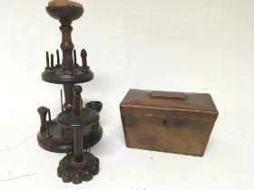 A 19th century treen bobbin holder and a 19th century tea caddy (2)