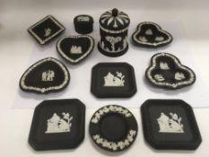 A collection of Wedgwood jasperware black basalt items.