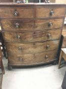 A Victorian mahogany bow fronted chest of drawers fitted with two short and four long drawers