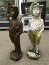 Two plaster figures of the whistling boy, approx h