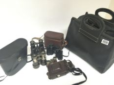 A collection of binoculars and cameras and a camera bag (a lot) - NO RESERVE