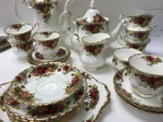 A royal Albert country rose tea coffee service including cups saucers jug coffee/ tea pot .