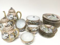 A Japanese eggshell tea set decorated with figures and applied gilt (a lot) - NO RESERVE