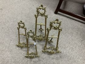 4 ornate brass picture frames.
