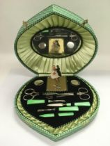A 1950s cased manicure set with musical movement.
