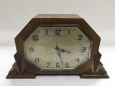 An Art Deco mantle clock with key, approx width 24cm.