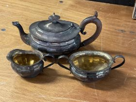 A 3 piece silver plated tea set together with a collection of silver plate and metalware - NO