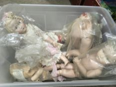A box of dolls, doll parts, child's Singer sewing machine and related books - NO RESERVE