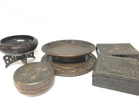 A collection of carved wood boxes and dishes inclu