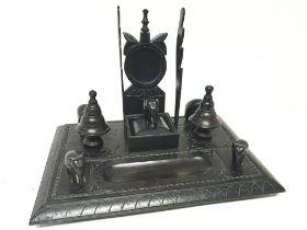 An ebony late Victorian desk pen tray each corner
