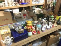 A collection of novelty teapots.