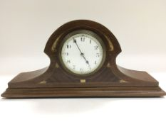 An Edwardian inlaid mahogany mantle clock.