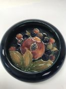 A small moorcroft swallow bowl decorated with pomegranate design. 10 cm - NO RESERVE