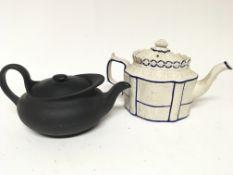 A Victorian moulded bisque type tea pot and Regenc