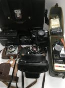 A collection of cameras and film equipment.