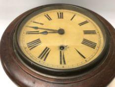 A mahogany case wall clock the circular dial with Roman numerals.