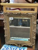 An early Wood and gesso frame mirror.