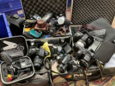 A Go-Pro hero 5 digital camera, A Carl Zeiss Werra and a collection of cameras and camera