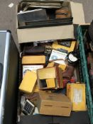 A box of vintage cameras with colour generation lenses and other camera equipment. No reserve.