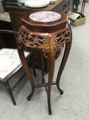 A carved bamboo jardiniere stand, the top inset wi