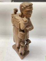 A carved African tribal figure with western influences. 40cm - NO RESERVE