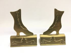 A pair of brass place holders in the form of boots, approx height 14cm - NO RESERVE