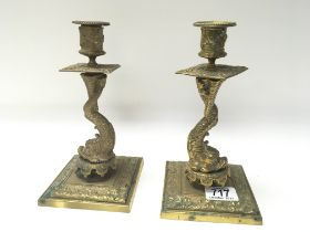 A pair of late Victorian brass candle sticks in th