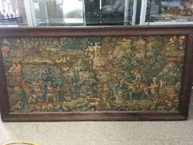 A 17th Century framed tapestry depicting figures in a woodland setting comprising a Lord and Lady