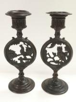 A pair of Victorian bronze candlesticks, one decor