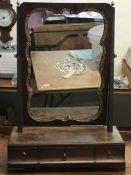 A small mahogany and gilt veneered table mirror wi