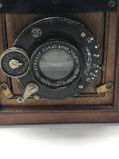 A small mahogany brass bound quarter plate camera .