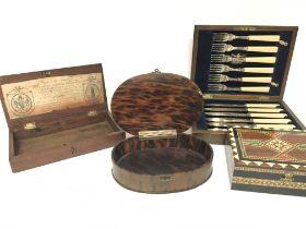 A late 19th century tortershell oval box a mahogan