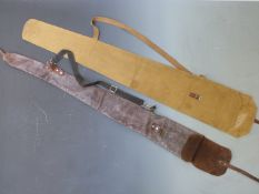 Two vintage gun slips, one leather the other canvas.