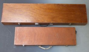 Two shotgun cases, one with fitted interior and metal bound corners (82 x 23 x 8.5cm) the other