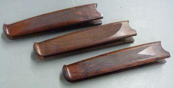Three Beretta chequered shotgun forends, each 26cm long.