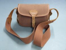 Brady leather and canvas shotgun cartridge bag with shoulder strap.