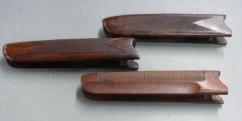 Three Beretta chequered shotgun forends, 24 and 24.5cm long.