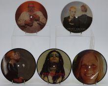 Twenty one 7 inch picture disc singles including Bad Manners, Adam Ant, Eurythmics, Lenny Kravitz,