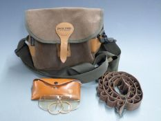 Jack Pyke leather shotgun cartridge bag together with a pair of Stirling shooting glasses in leather
