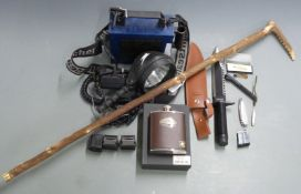 A collection of gun and shooting related items including Nightsearcher 750, Rambo First Blood