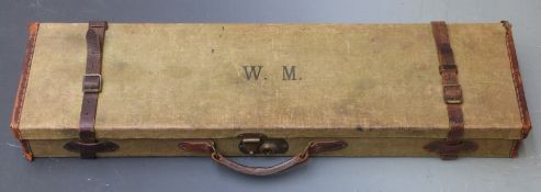 Vintage canvas and leather bound shotgun case with fitted interior and original label 'T.