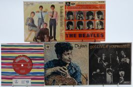 Approximately 70 singles and EPs by the Beatles, The Rolling Stones and Bob Dylan