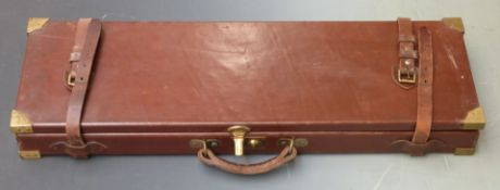 Leather or similar bound gun case with fitted interior, brass lock and corners and 'William Powell &