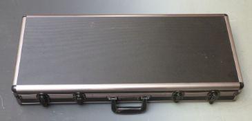 Shotgun or rifle hard flight or travel case with padded interior, 81x34x12cm.
