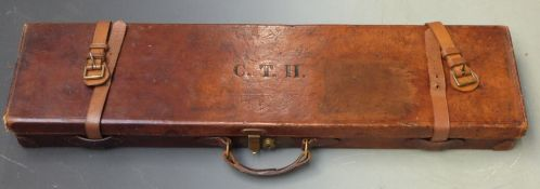 Leather gun case with fitted interior and brass lock, 82x21.5x8cm.