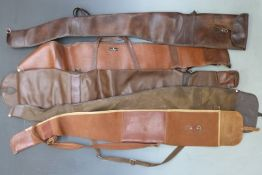 Five leather and similar gun slips.