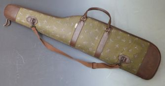 Padded shotgun or rifle slip with decoration of ducks and cartridge bags.