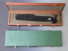 Two wooden shotgun or rifle hard carry cases, 115 x 29 x 11.5cm and 80 x 25 x 8cm.