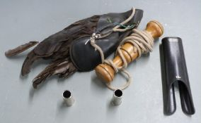 A falconry lure together with 12 bore shotgun snap caps and a forend hand protector.