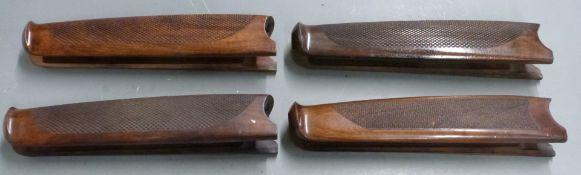 Four Beretta chequered shotgun forends, each 26cm long.